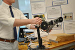 At the conference, Maxwell Winslow demonstrated a robotic prosthetic arm that responds to sensors worn around the bicep.